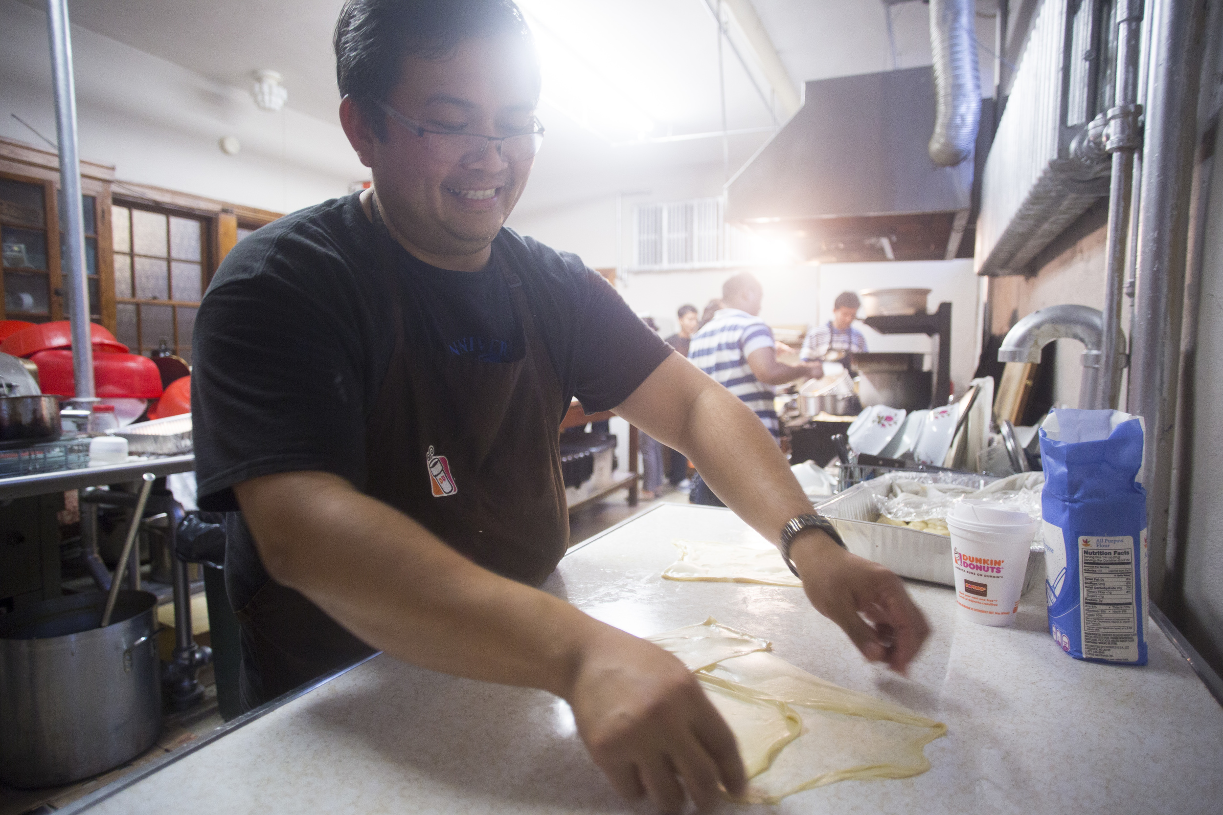 Reverend Maung Maung Htwe has been preparing food for the Burmese Food Fair all morning. By Ann Wang