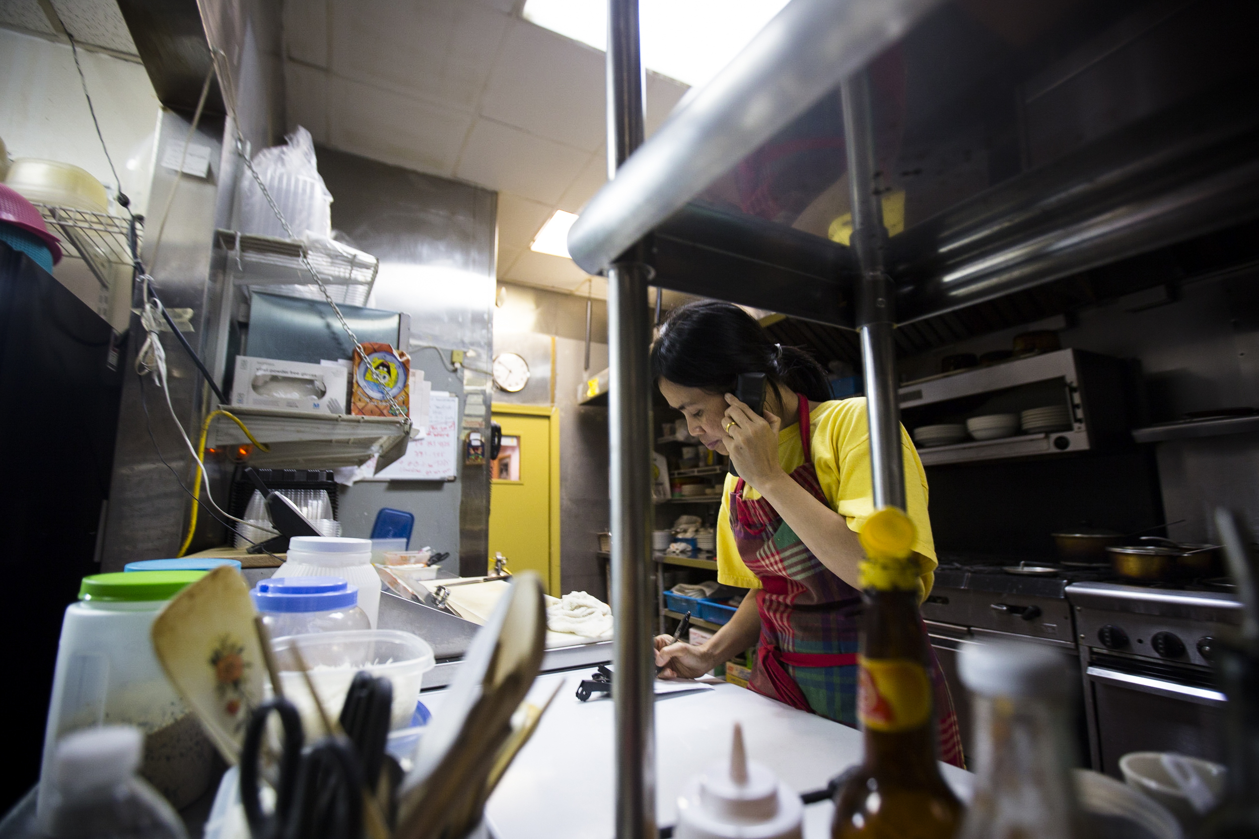 Thawdar Kway, the wife of Yoma's owner. Due to visa problems, she was separated with her husband for almost a year, waiting alone for the visa to be processes in Bangkok, Thailand. Now she helps out in kitchen of Yoma. By Ann Wang