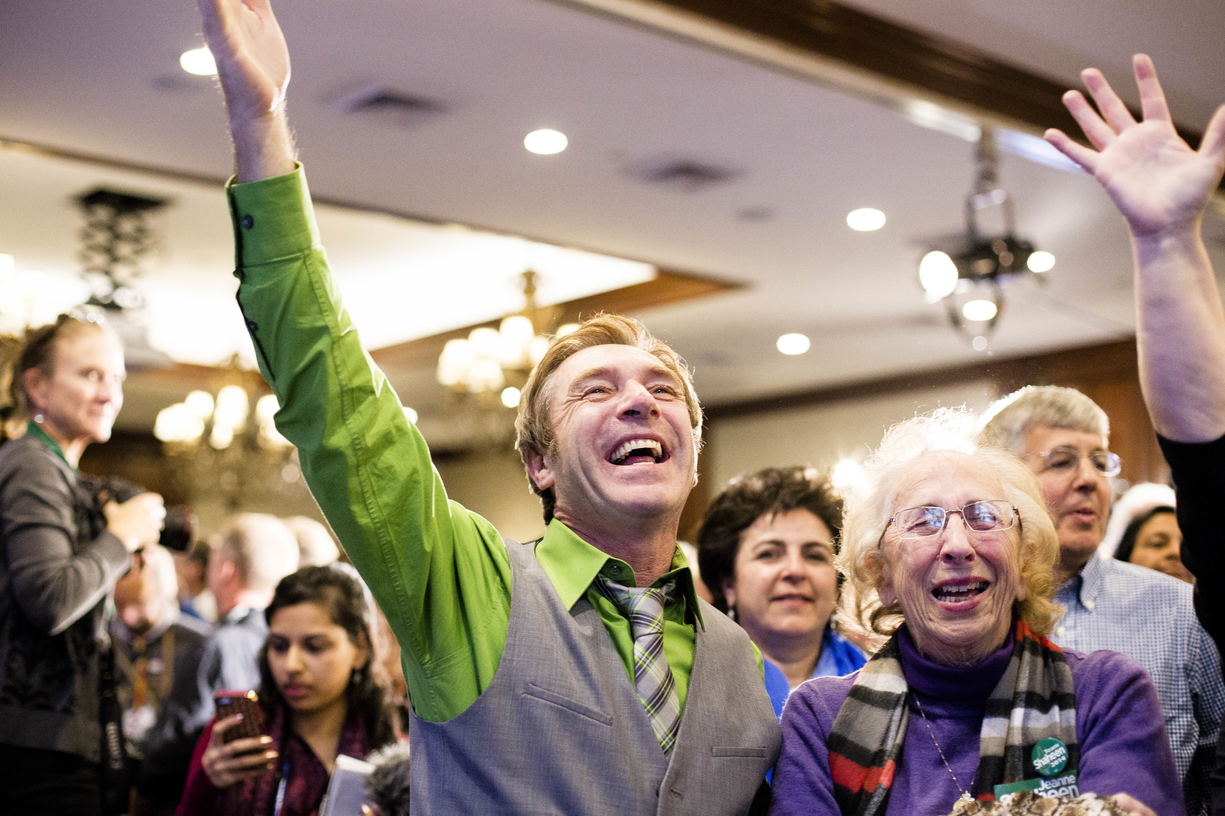 Manchester, NH, USA. Nov.4, 2014. Peggy Shaheen(center), 81 and Kevin Fennelly (left) cheers after Shaheen won the Senate Seat. Photo By Ann Wang