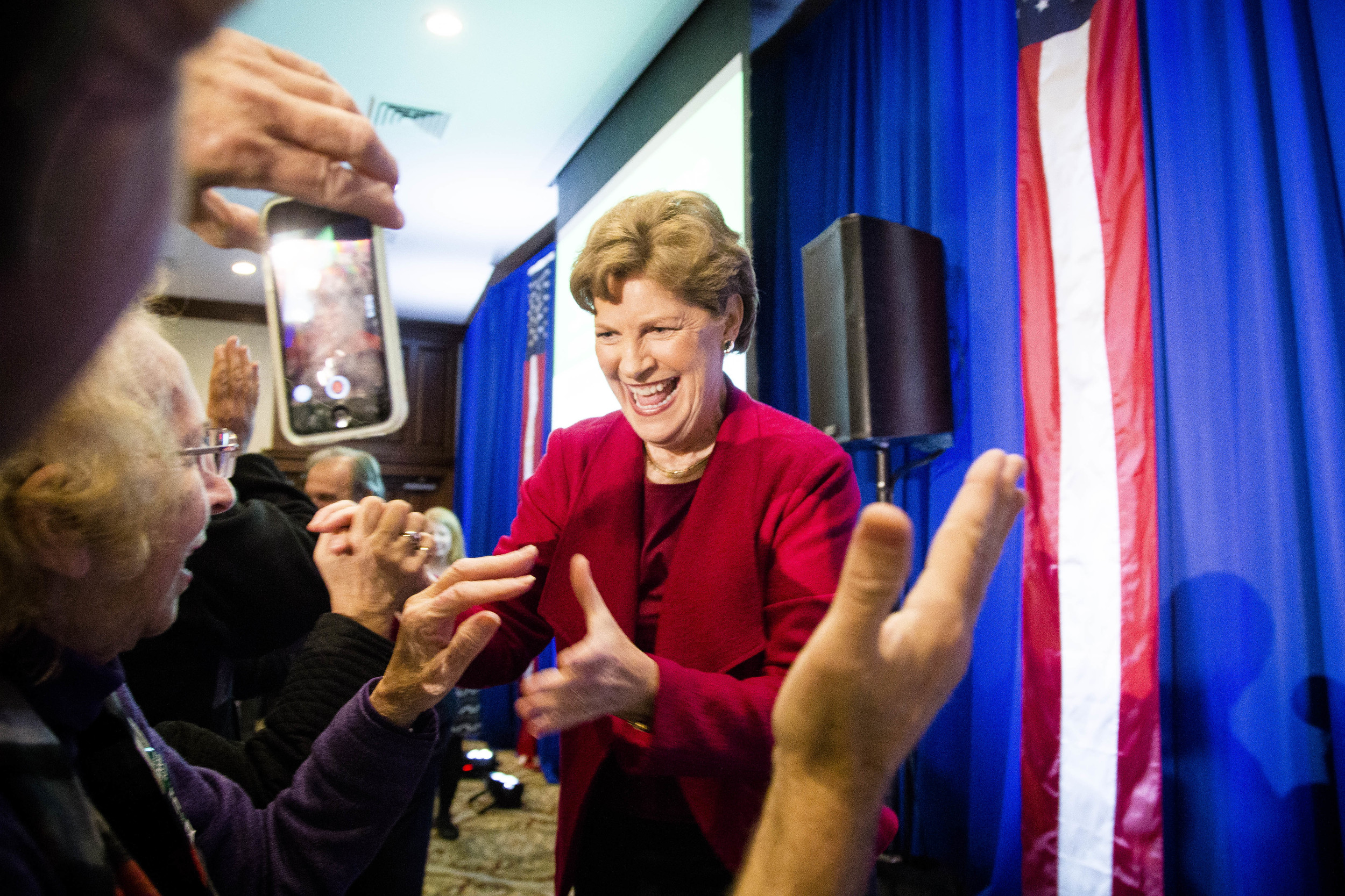 Manchester, NH, USA.Nov. 4, 2014. After Shaheen defeats Brown to keep Senate Seat. She was greeted by supporters while walking into the Puritan conference center in Manchester, New Hampshire. Photo by Ann Wang