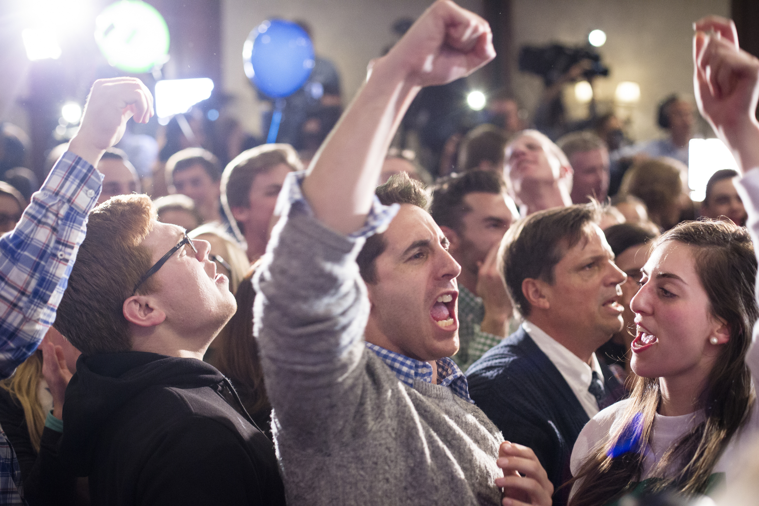 Manchester, NH, USA. Nov.4, 2014. Shaheen supporter, Scott Messick (center), 29, cheers after Brown give his conceded. Photo by Ann Wang