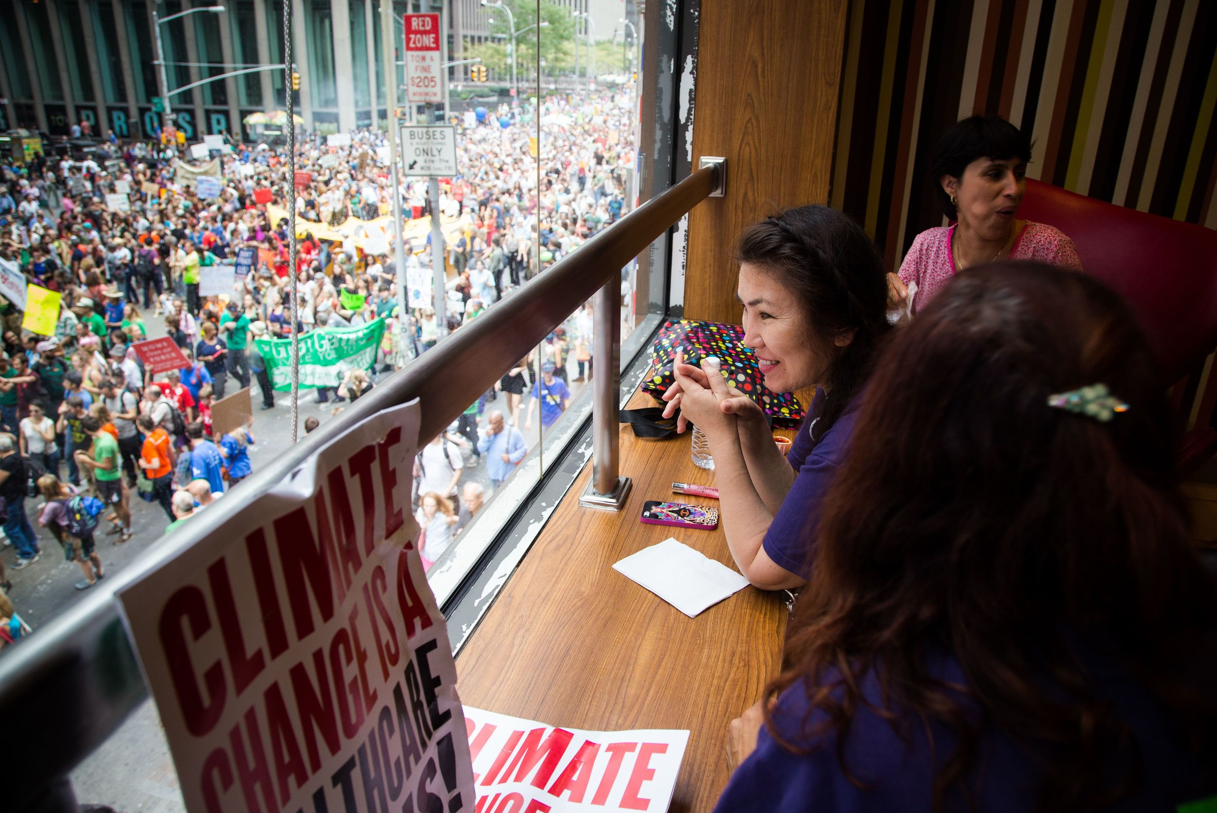 Elmira Muradova (M) and friends relaxing on the second floor of  McDonald's while watching the Climate Change march in New York City. By Ann Wang