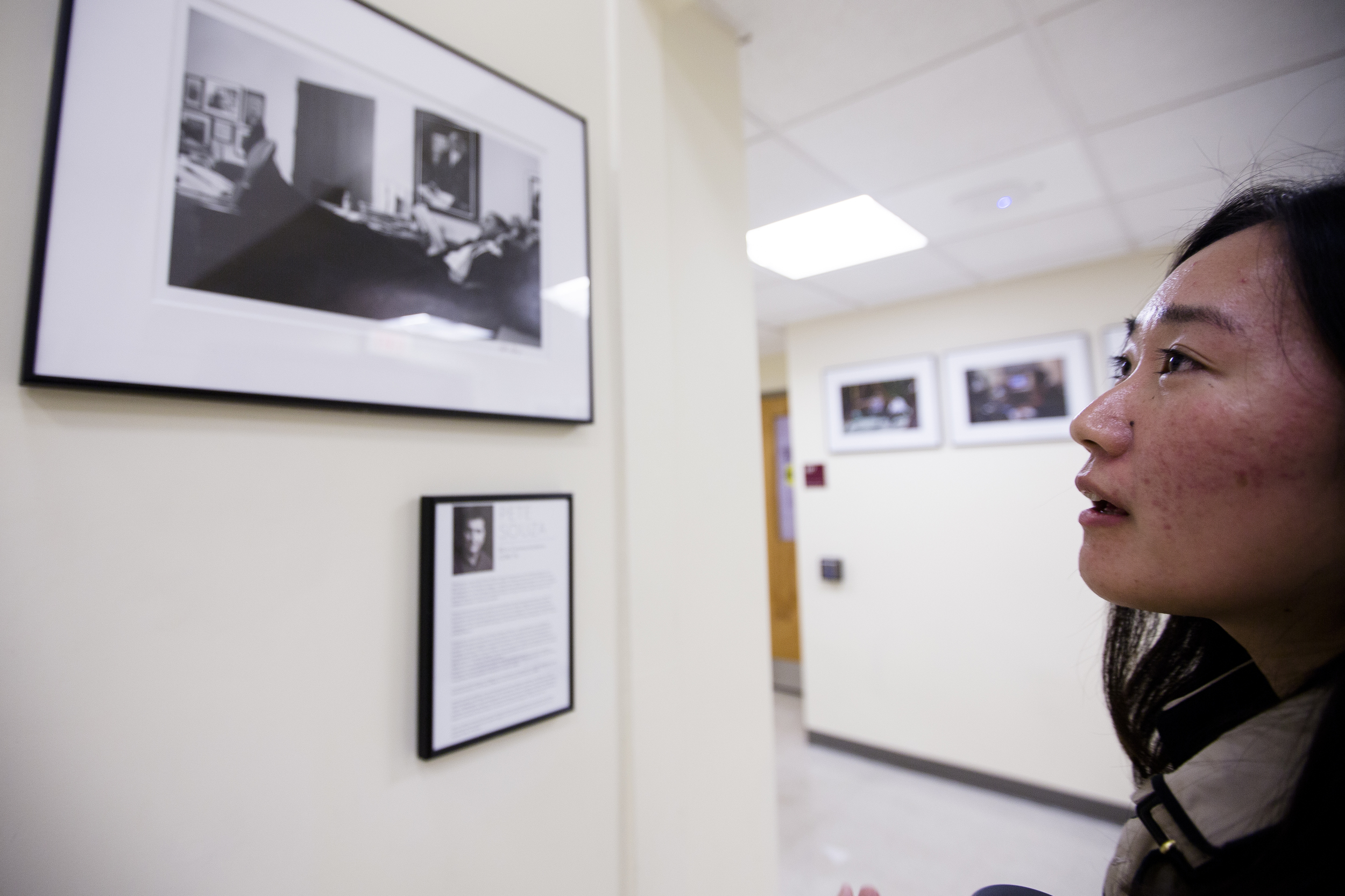 Yanshu Lee, a Boston Univeristy graduate student viewing photos of Obama released by the White House. Photo by Ann Wang