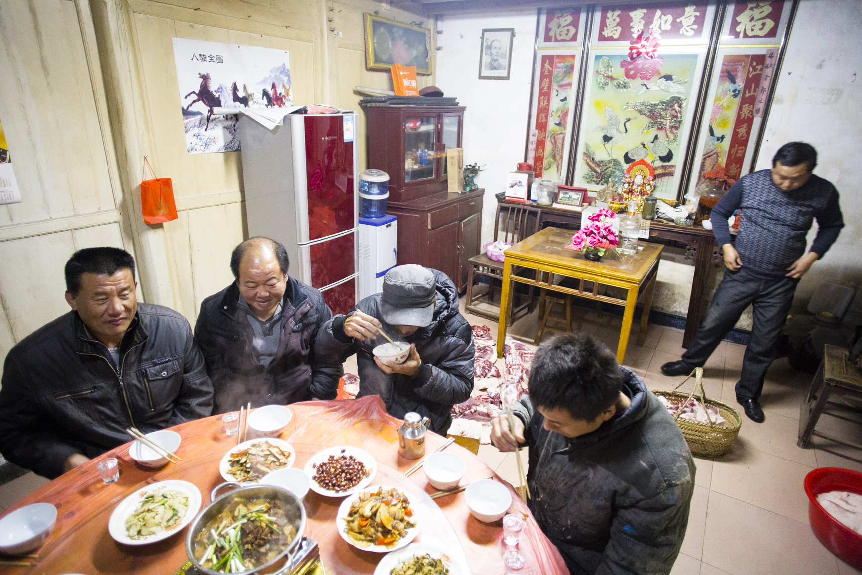 MG_1292 The raw pork were left to cool off on the floor in the living room while men enjoy dinner after the hour long slaughtering. Photo by Ann Wang