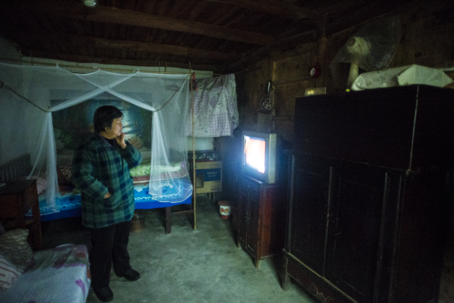 MG_1416 Many elders spend their day watching television instead of working, because the youngsters sends money home while working in the big cities. Photo by Ann Wang