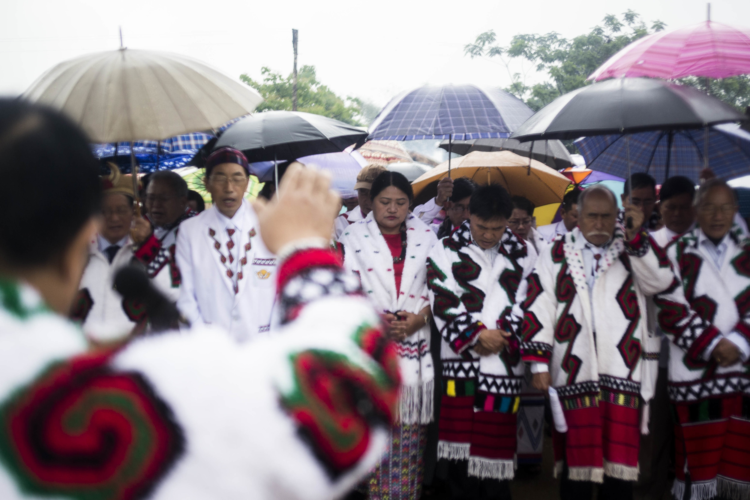 Rawang elders lead a prayer before the festival starts. Photo by Ann Wang