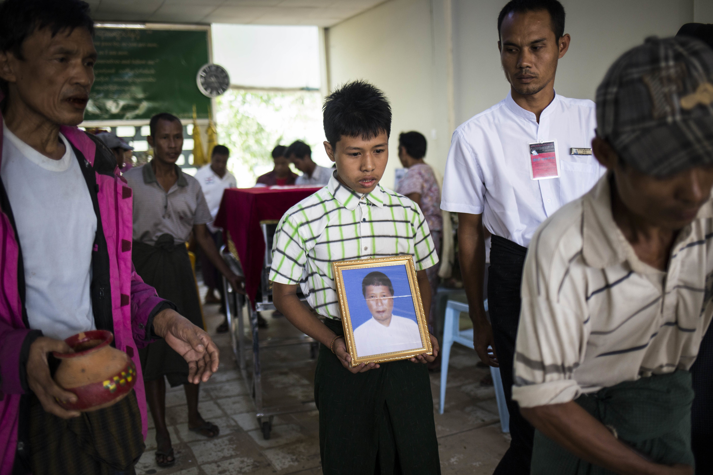 The funeral of a 41 year old alcoholic, he left behind his wife and three boys. Photo by Ann Wang