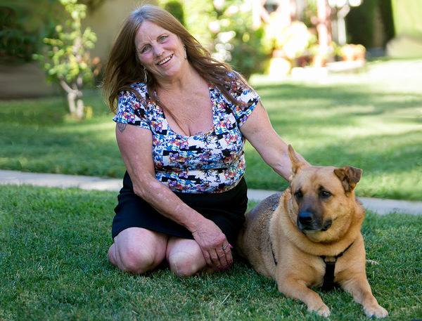 Dorothy Edwards, pictured here with her dog Gunnar, experienced homelessness firsthand. She now has a home and serves as an advocate on the board of the Corporation for Supportive Housing.