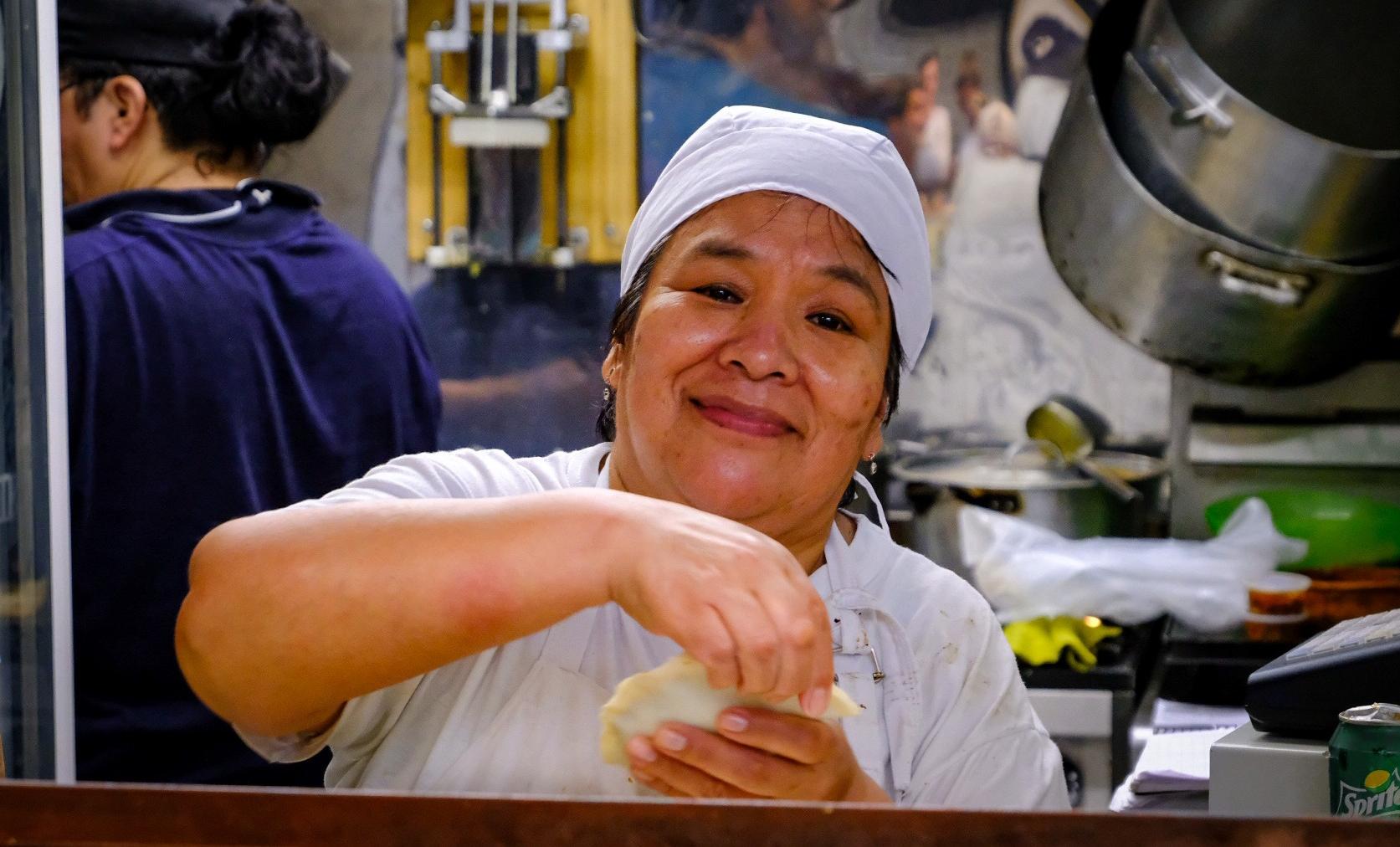 Vendor making an empanada in Buenos Aires