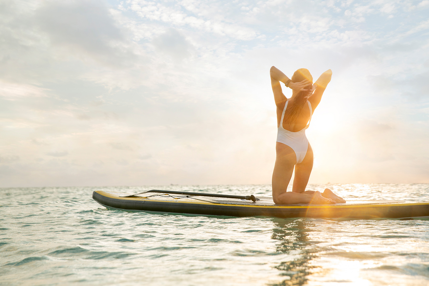 miami_lifestyle_beach_fitness_photography_david_gonzalez_girl_outdoor_workout-woman-on-a-paddle-board-enjoying-the-sunrise.jpg