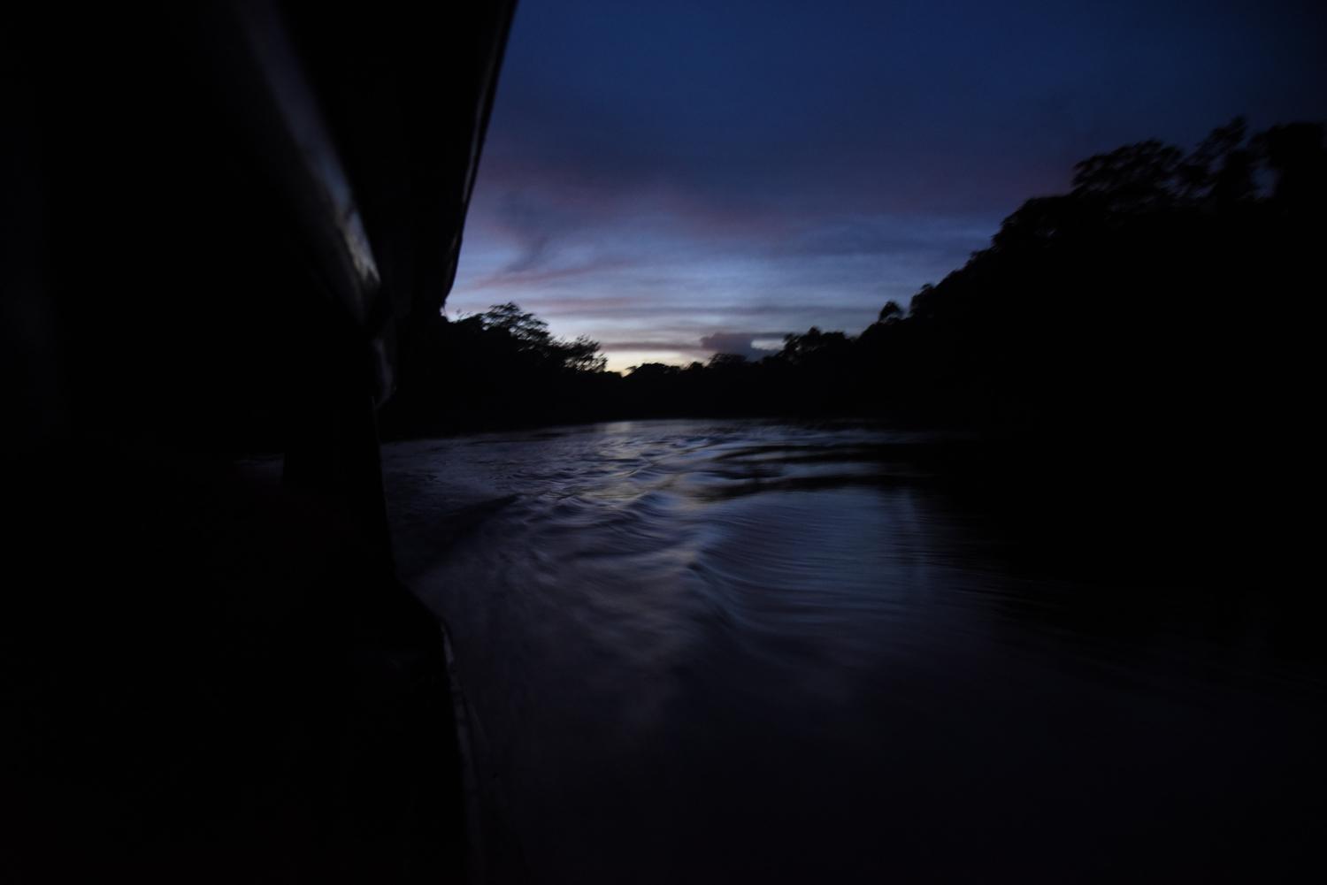Boat driver, Manfred Cruz Zuvieta, navigates the last several hours of the journey to Pampas de Heath by night before arriving to camp across the river in Bolivia.