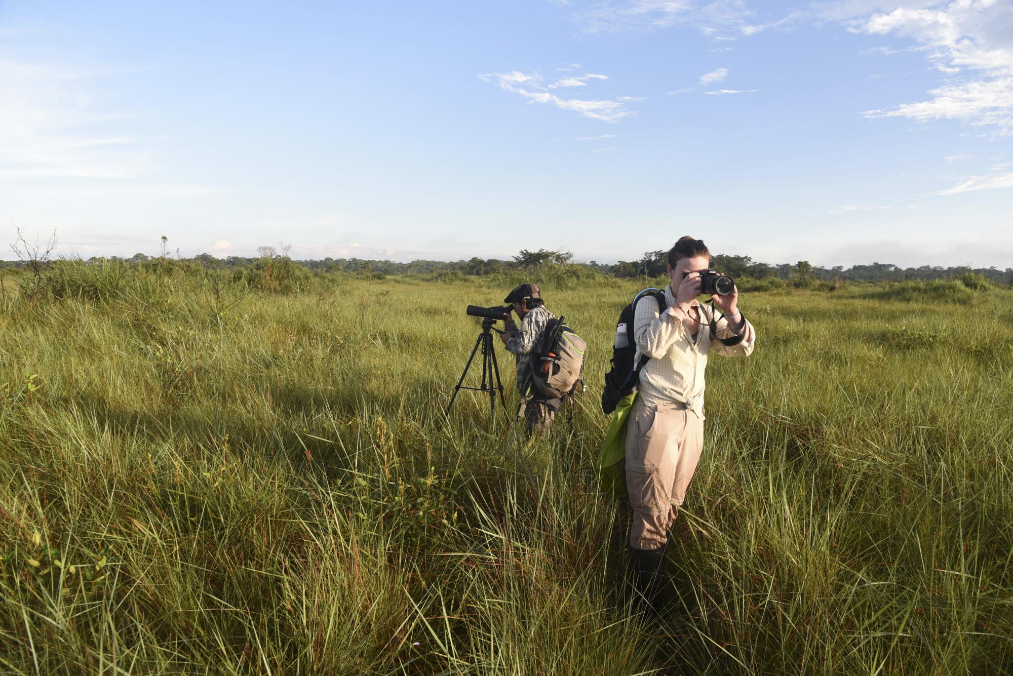 Yohamir and Maisie survey the grassland for bird species.