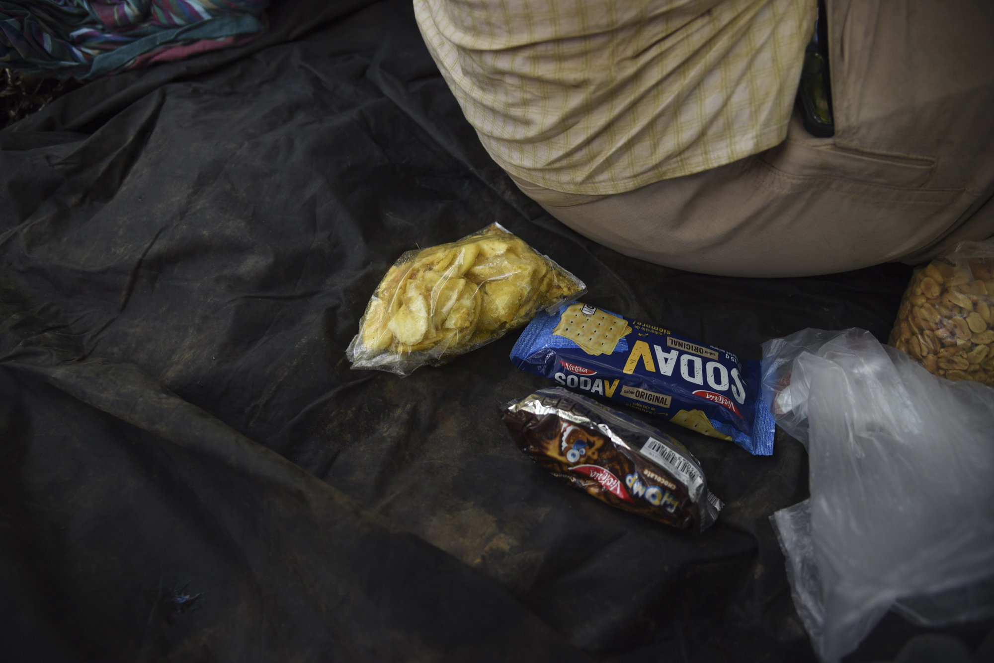 Chiflas (plantain chips), crackers, cookies and peanuts and other snacks help refuel the group to continue the search.