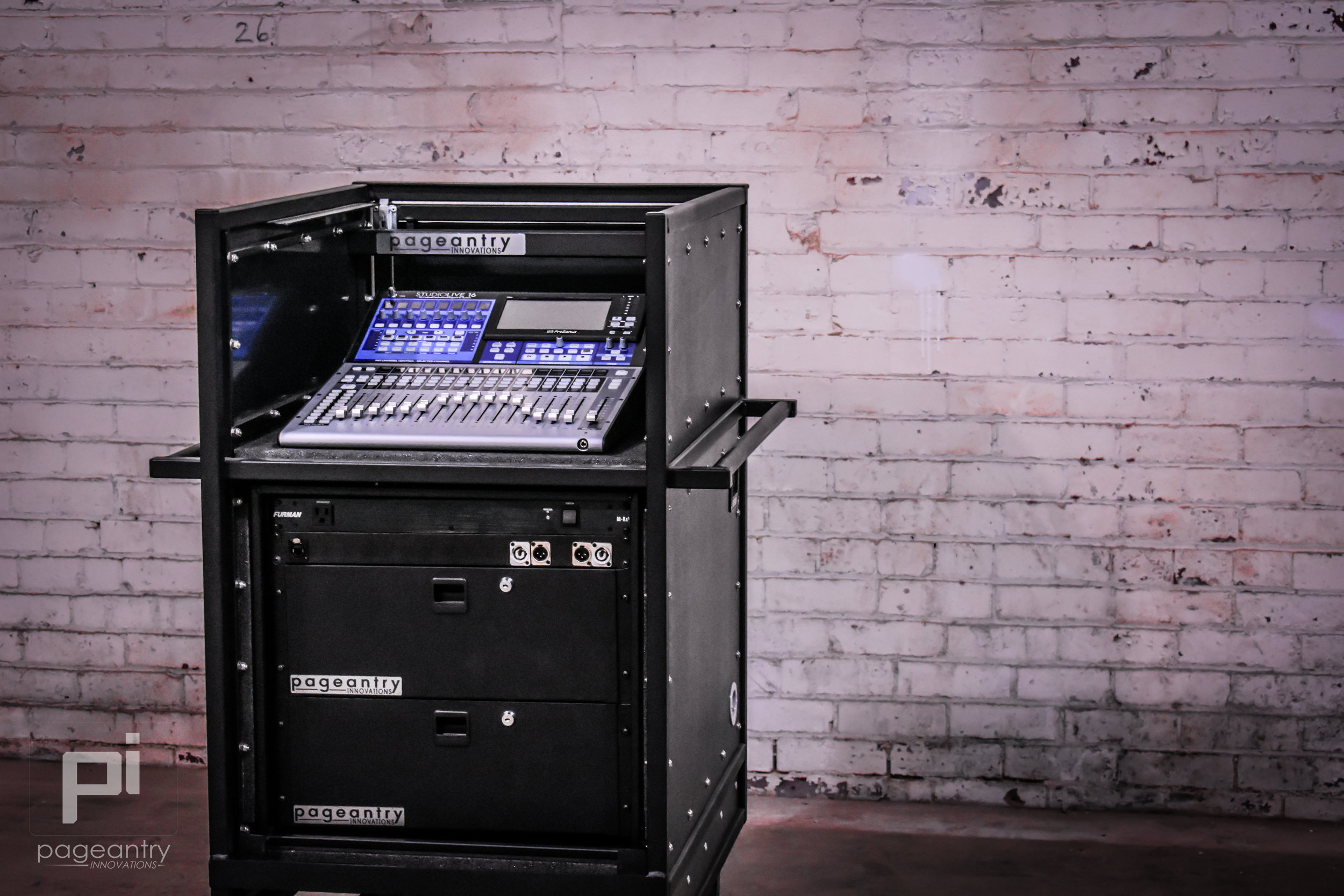 The 10u rack is housing a custom rack panel, power conditioner, & two rack drawers.