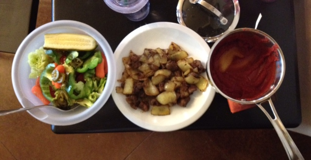 """Kidney cooked with onions seasoned with turmeric and curry powder. Homemade """"ketchup"""" is on the right."""