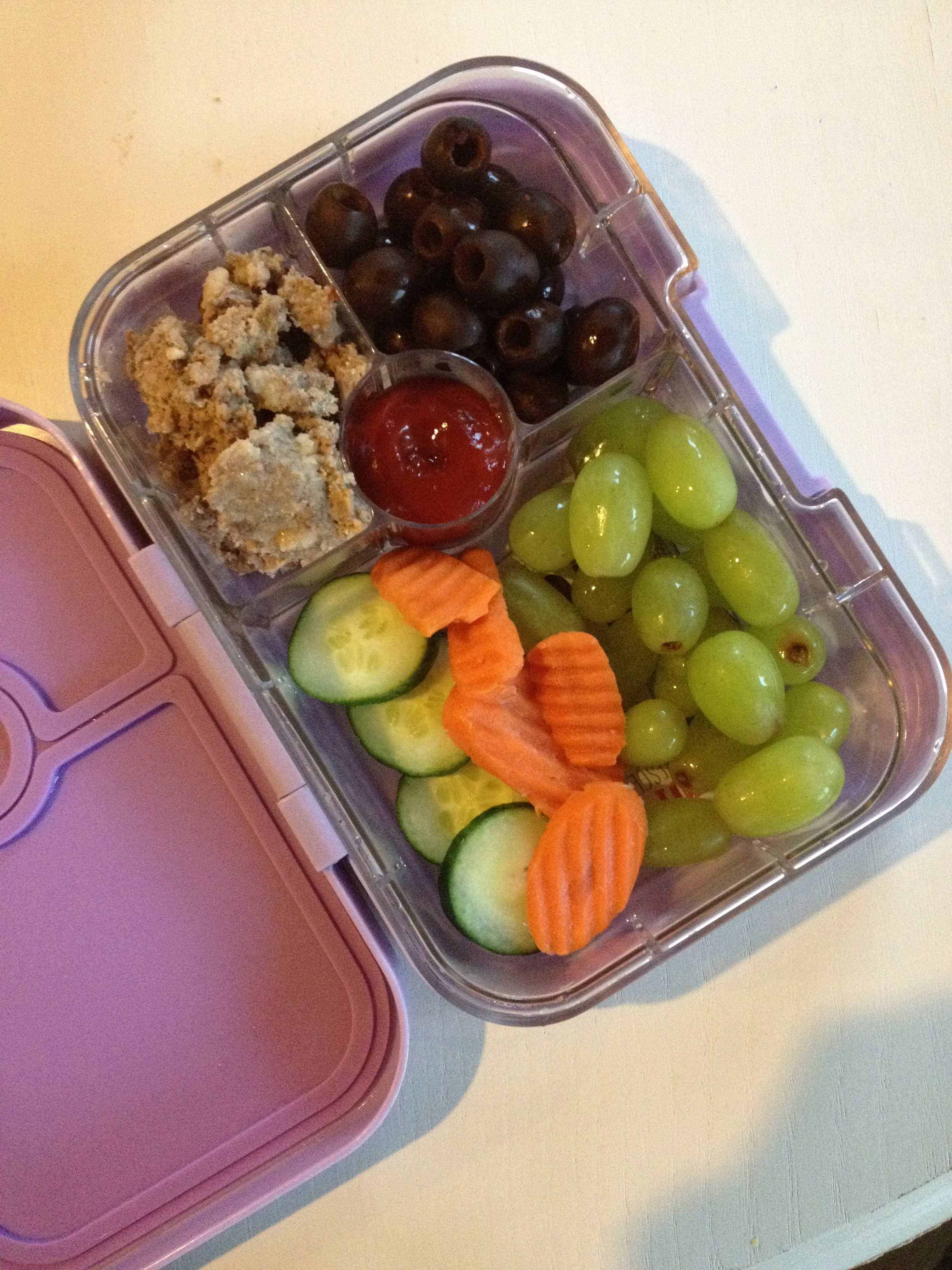 Leftover meatloaf, black olives, green grapes, cucumber and carrot slices. Always include ketchup. Ketchup is key to getting my baby to eat her meat