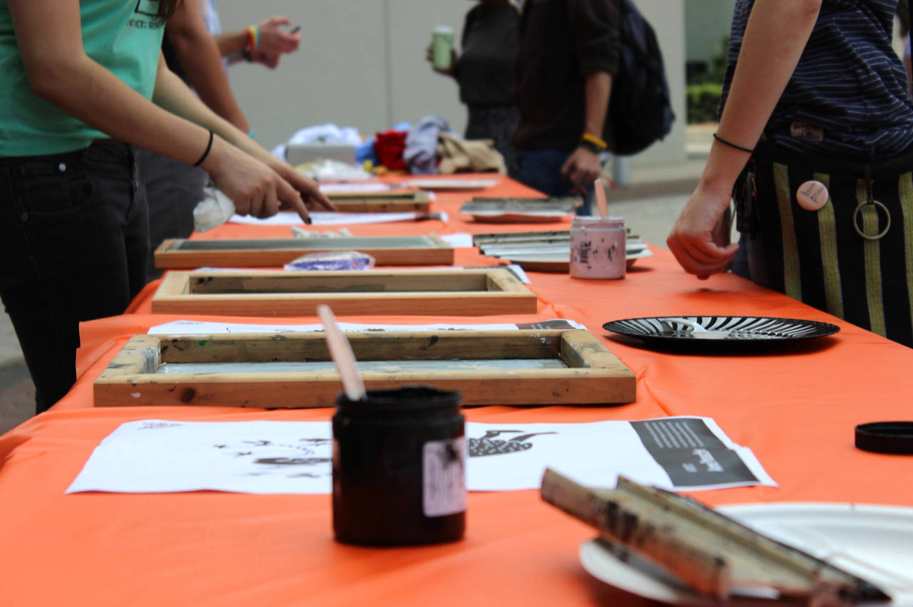 Nine artists, both students and alumni, submitted designs to be printed onto donors' shirts.
