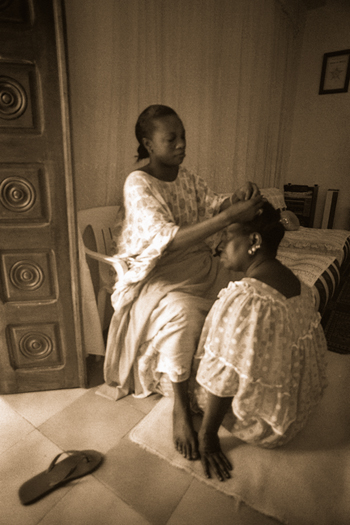 Untitled: Women Braiding Hair