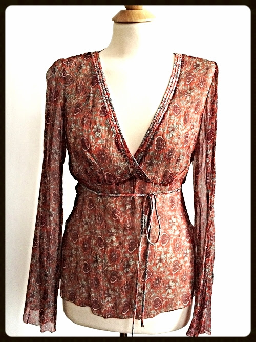 http://www.houseofterrance.com/clothing/elie-tahari-silk-chiffon-floral-blouse