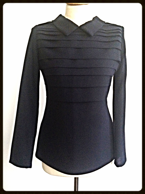 http://www.houseofterrance.com/clothing/collared-pleated-wool-blouse
