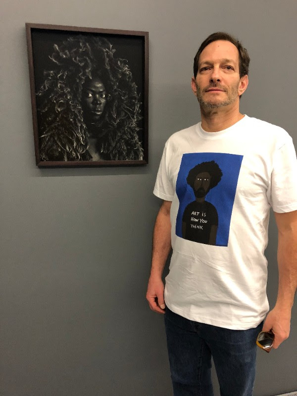 Robert in his Patrick-Earl for H*O*T   Art is How You Think   t-shirt in front of the haunting photography of  Zanele Muholi .