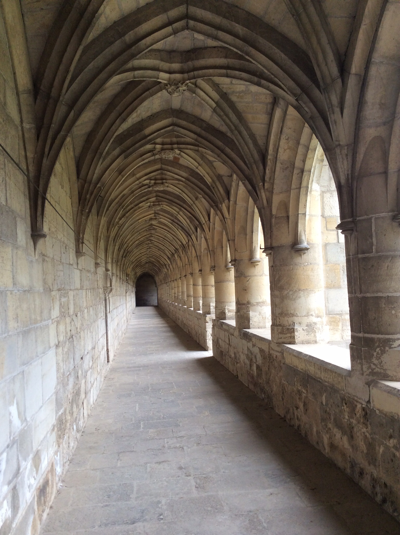 This walk, goes all around the green space, and is called the ambulatory and is where the monks walked. They were, at death, buried in the green space.