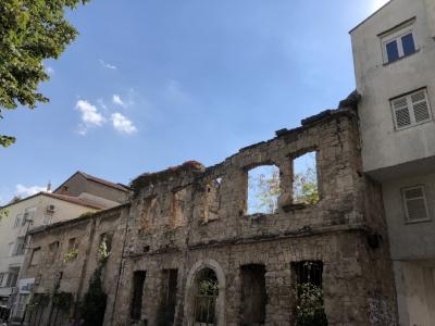 Bombed Ruin Between Two Inhabited Buildings