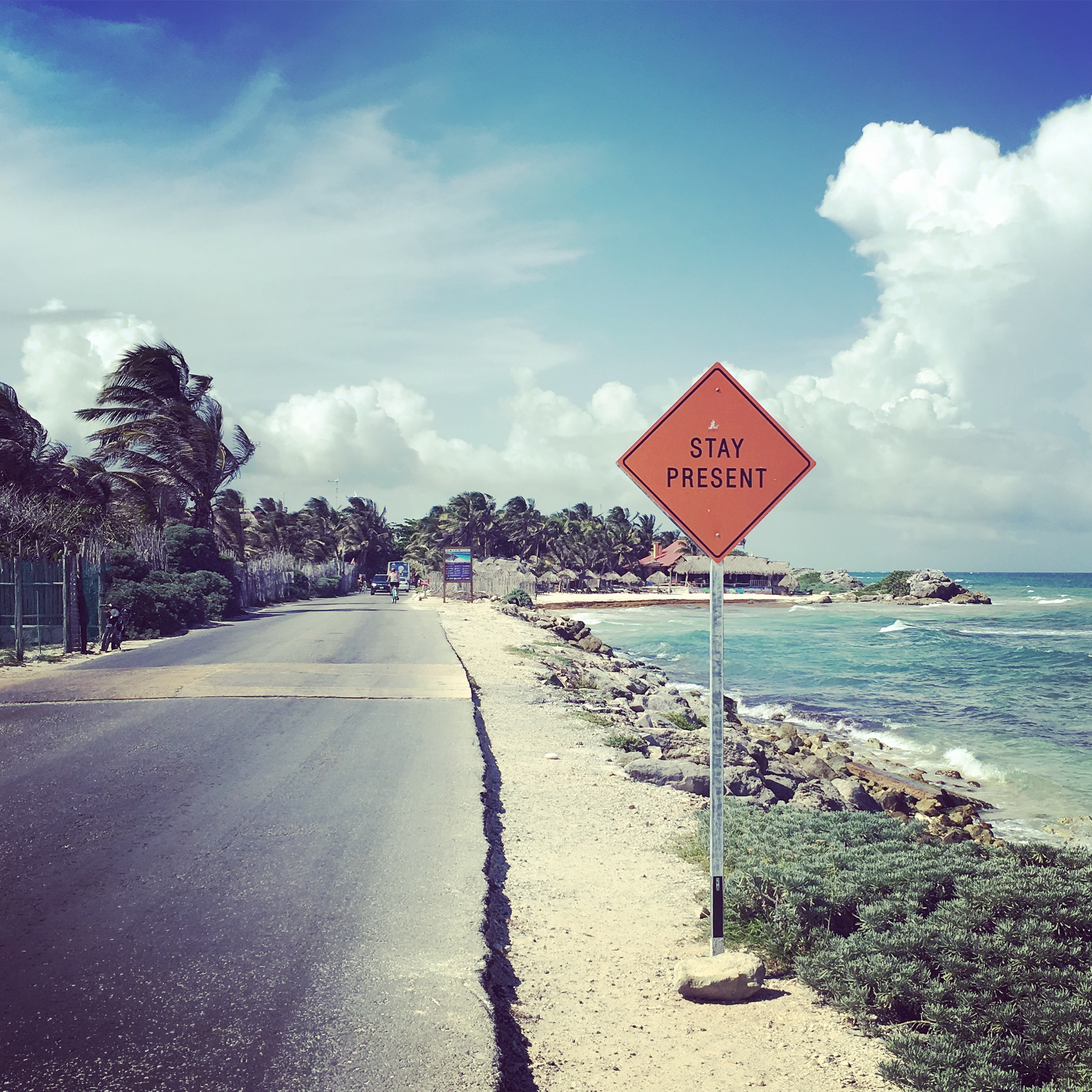 "These street signs dot the road between Tulum and Cancun. ""Stay Present"""