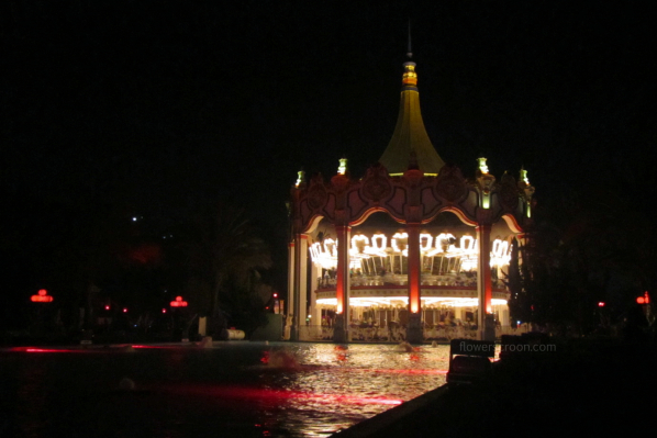The classic carousel lit up at night