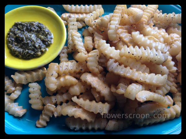 Crinkle cut CravOn Fries sprinkled with fresh cracked pepper and served with pesto
