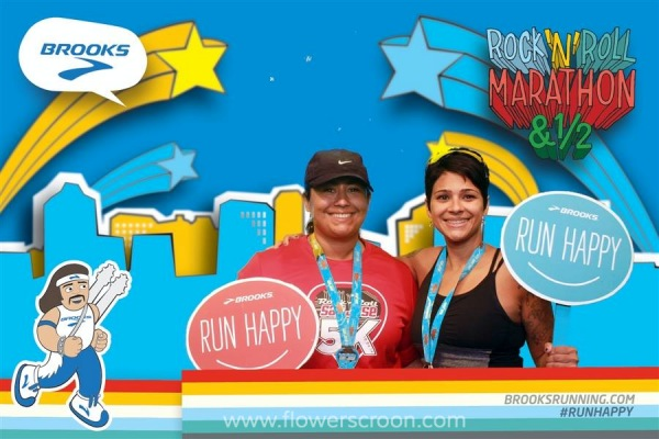 My friend Laura and I after the 5K at the Brooks photo machine inside the Expo