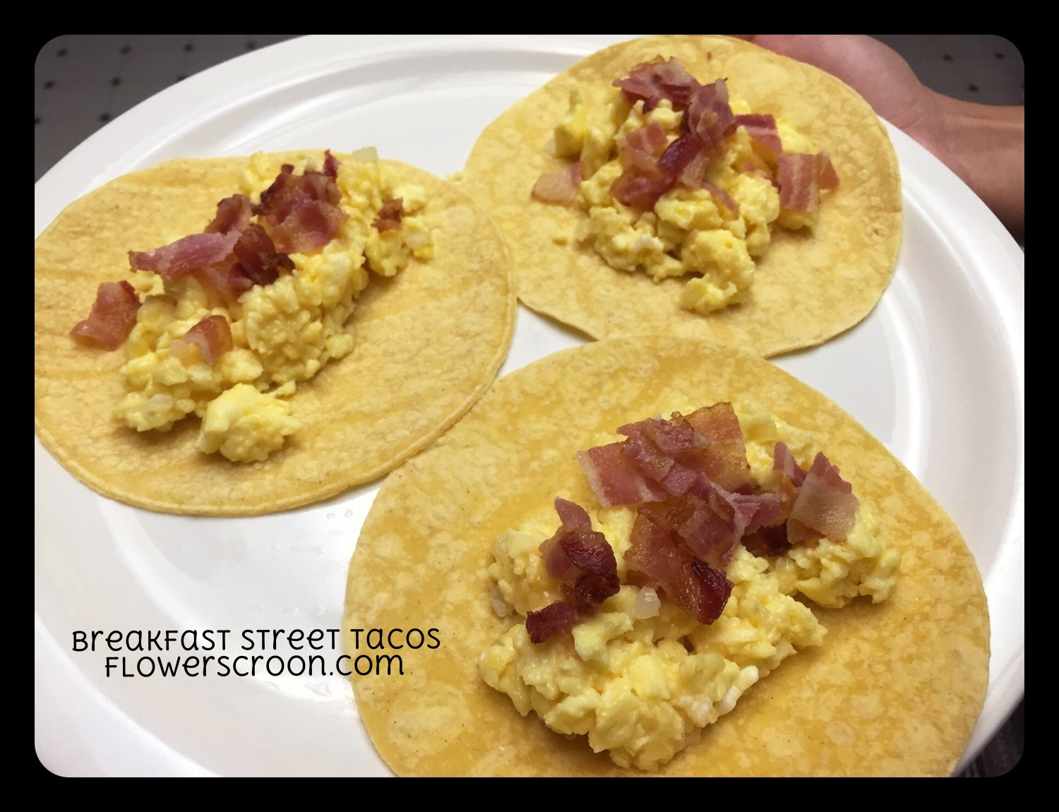 Breakfast Street Tacos: eggs, onions, cheese, turkey bacon, pepper and corn tortillas
