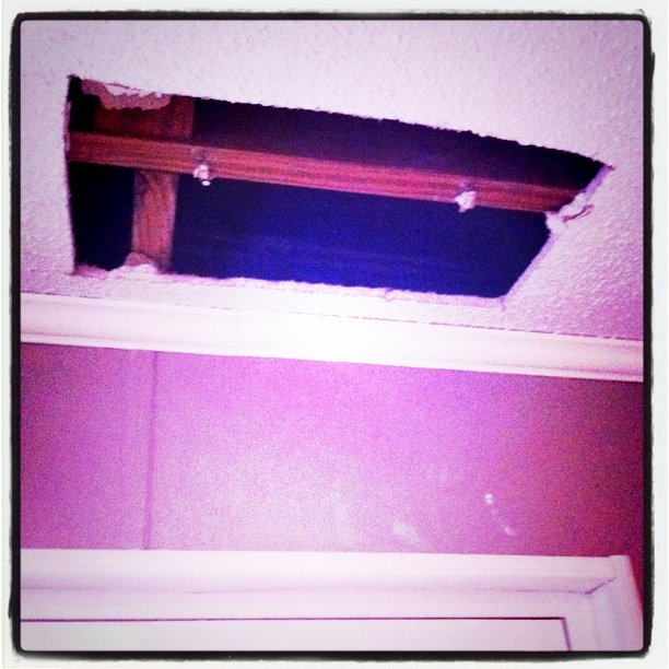 The huge hole in the ceiling. Awful.