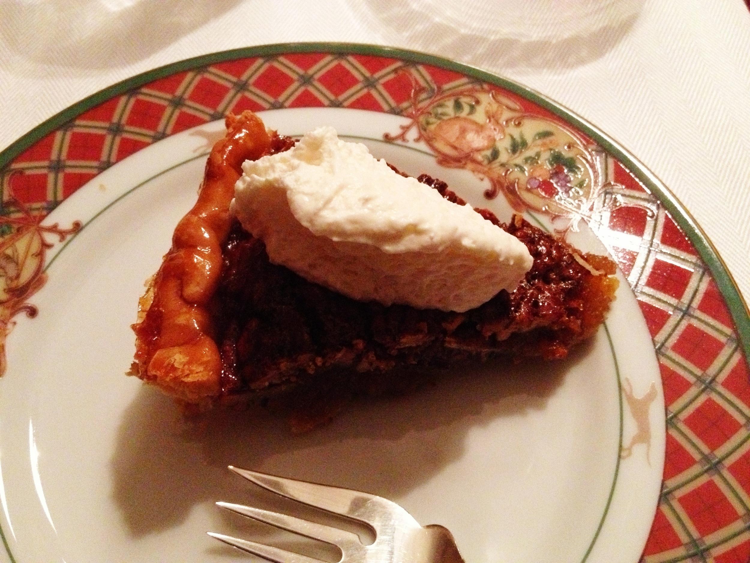 Homemade pecan pie with homemade whipped cream