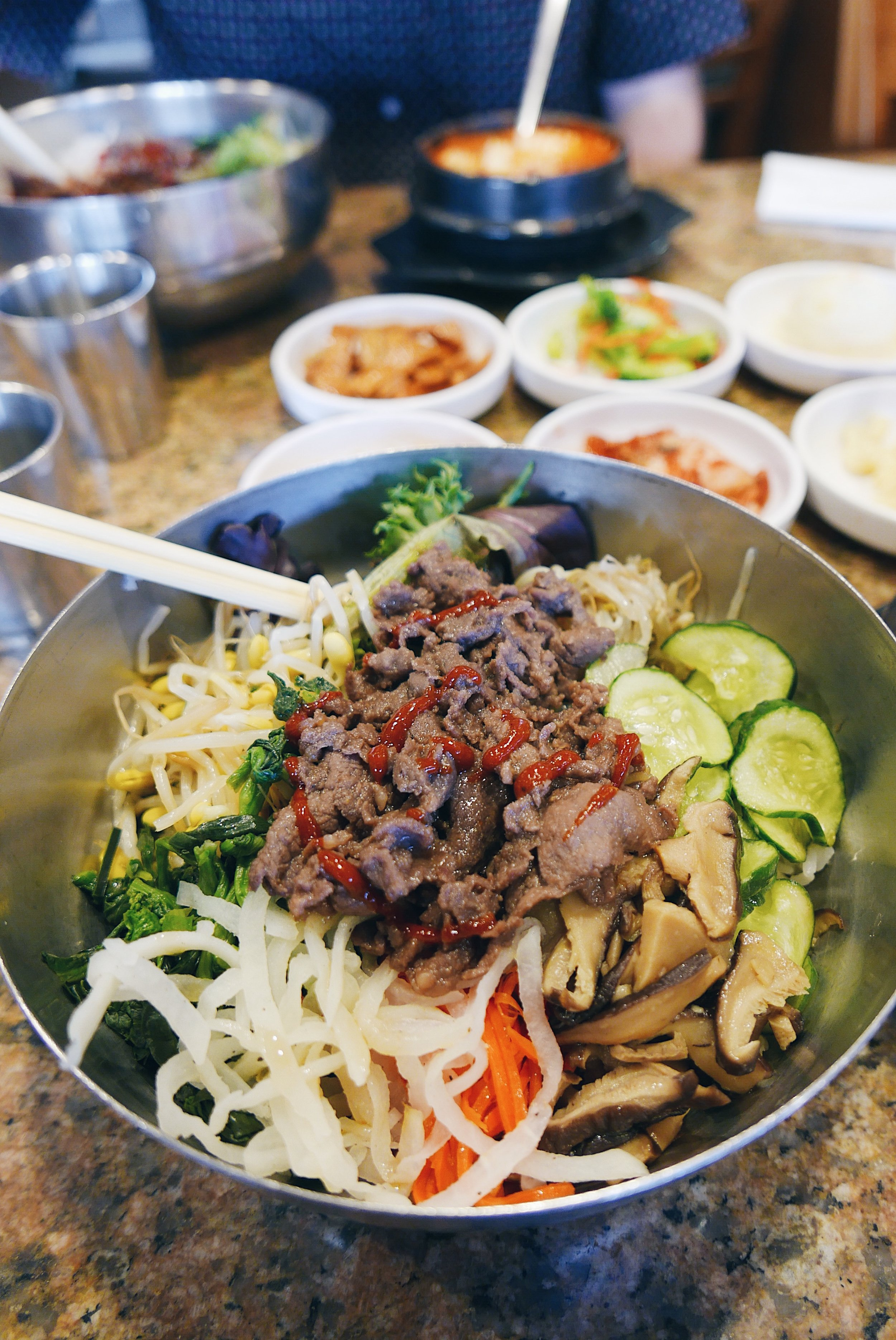 soondubu + Bibimbap = a perfect combo! - Why settle for a side of rice when you can get an entire bowl of rice with veggies and beef bulgogi? This bulgogi bibimbap is the perfect pairing for the hot soondubu.If you're really in the mood to sweat while eating, you can get your bibimbap in a hot stone bowl, too. But I've learned that a great combo is regular bibimbap -- cold -- with the hot soondubu. It's a good balance of temperatures, and sometimes I even like to pour soondubu broth onto my bibimbap.