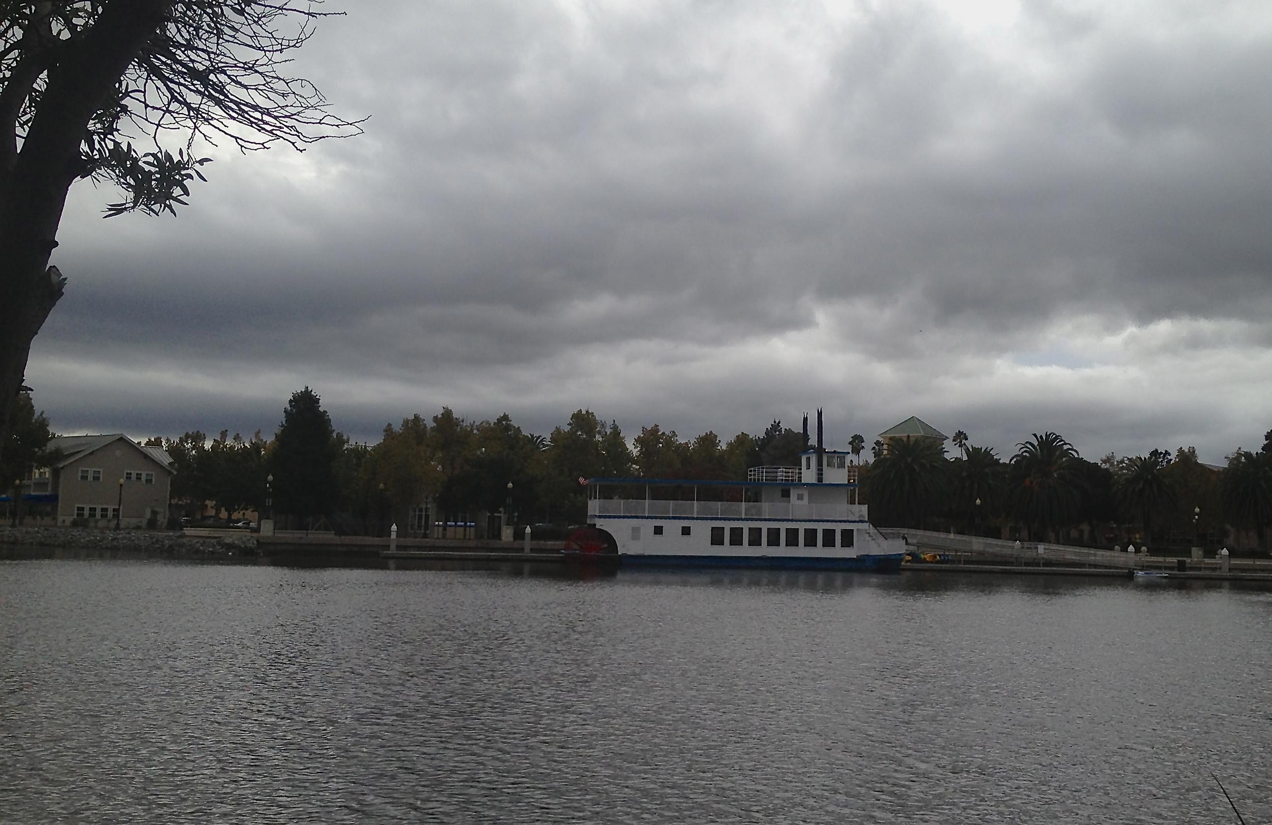 Riverboat Matthew McKinley docked under storm clouds - Suisun Waterfront