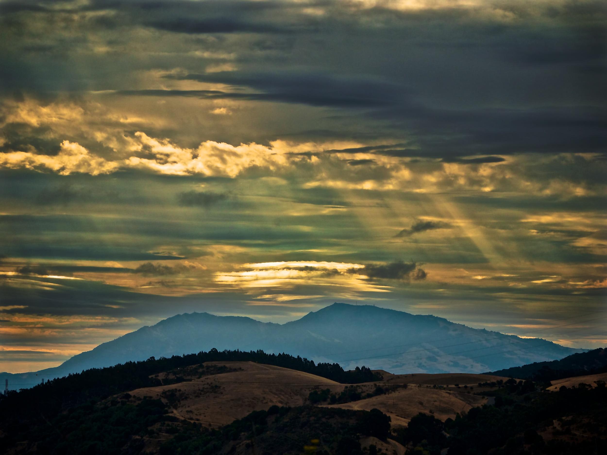 Sunlight streams through the clouds above Mt Diablo