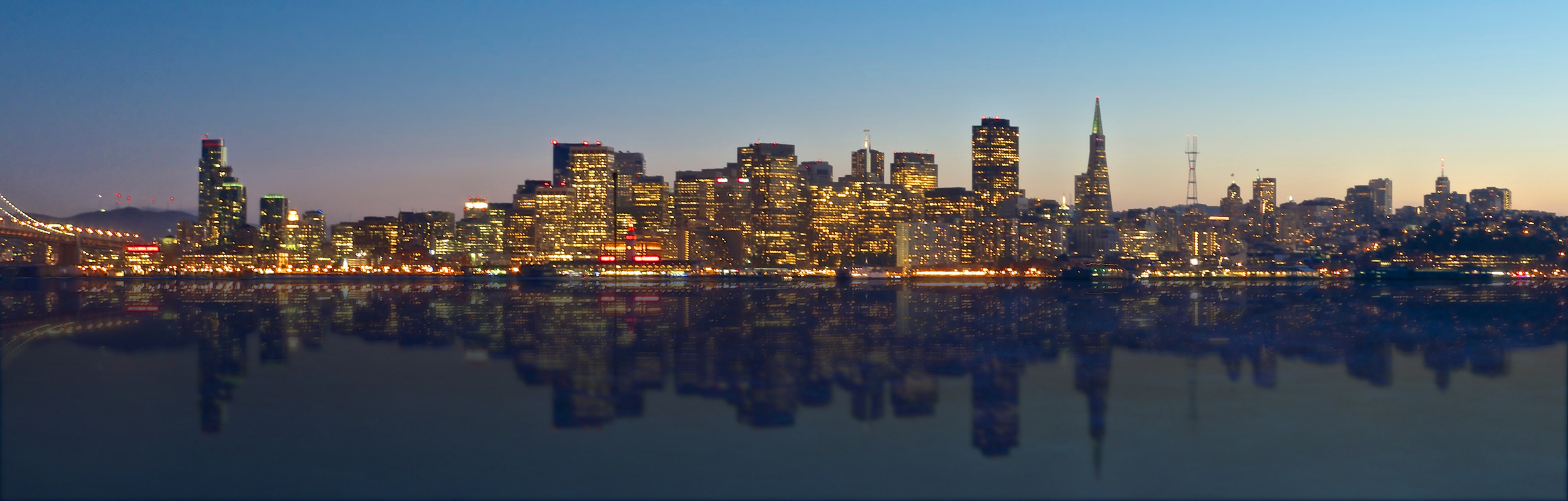 San Francisco skyline with reflection on the bay.