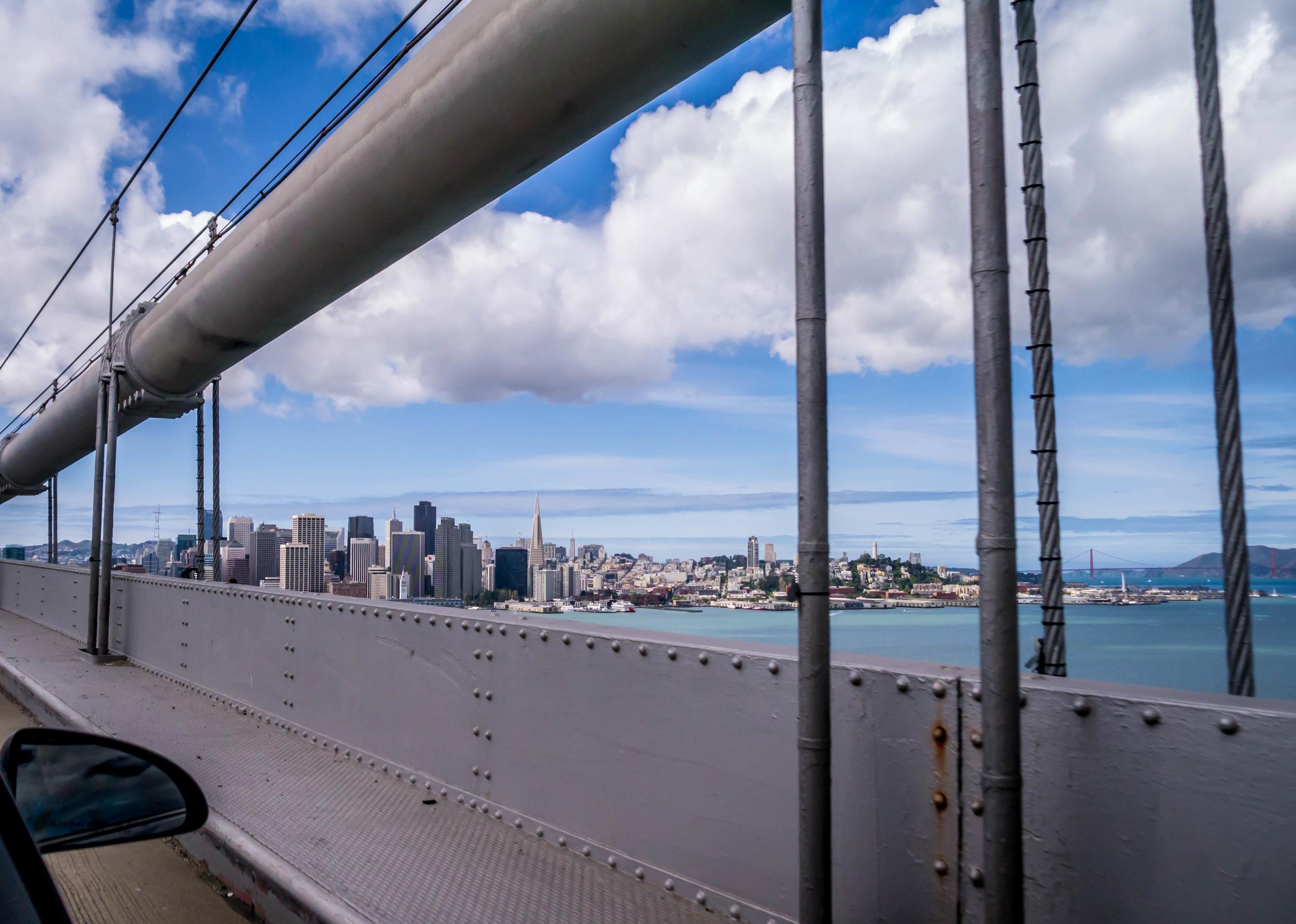 A bridge under fluffy white clouds