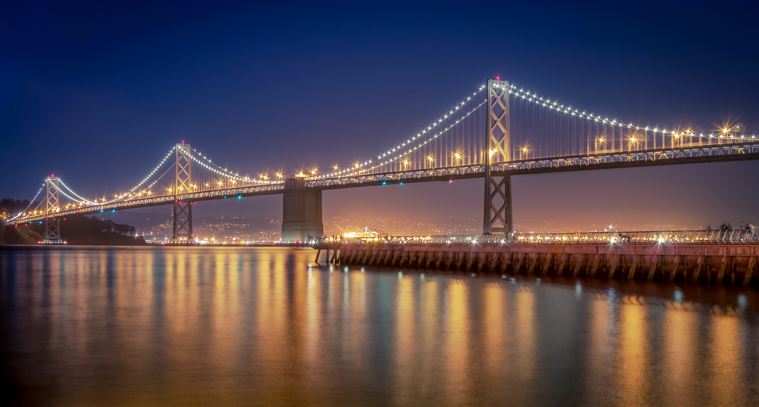The spectacular lights of the Bay Bridge.  Buy a print via Zazzle.com