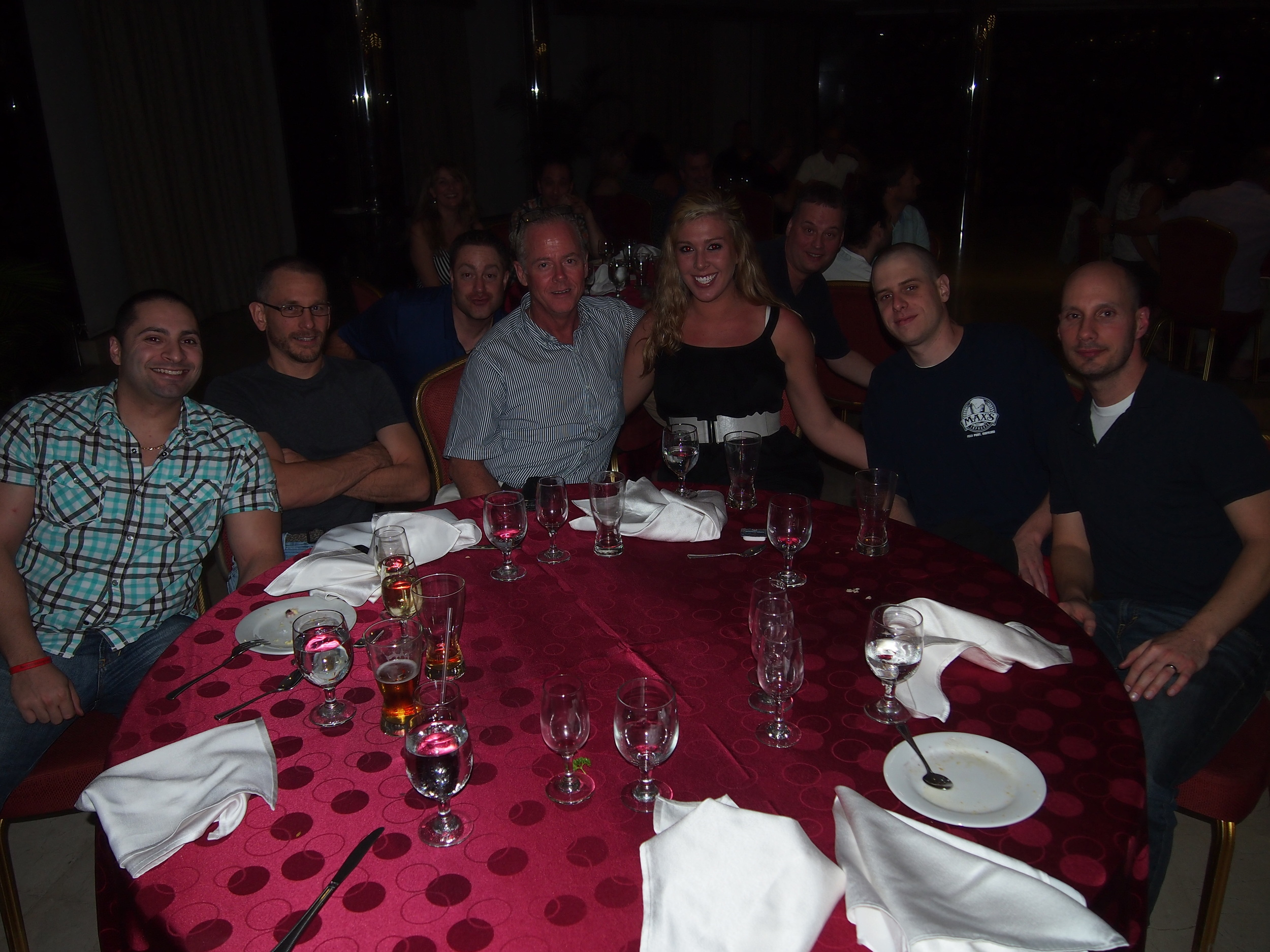 This is from our team dinner Wednesday night. Seated at the table are Paul, Steve, Mike, Lisa, Mike and Adam. Photo-bombing in are Dominick and Ron.