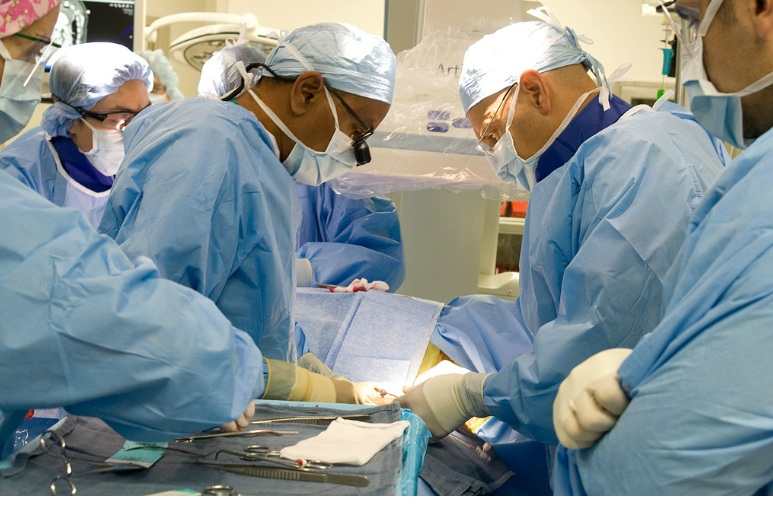 Surgeons operating in Hybrid Surgical Lab