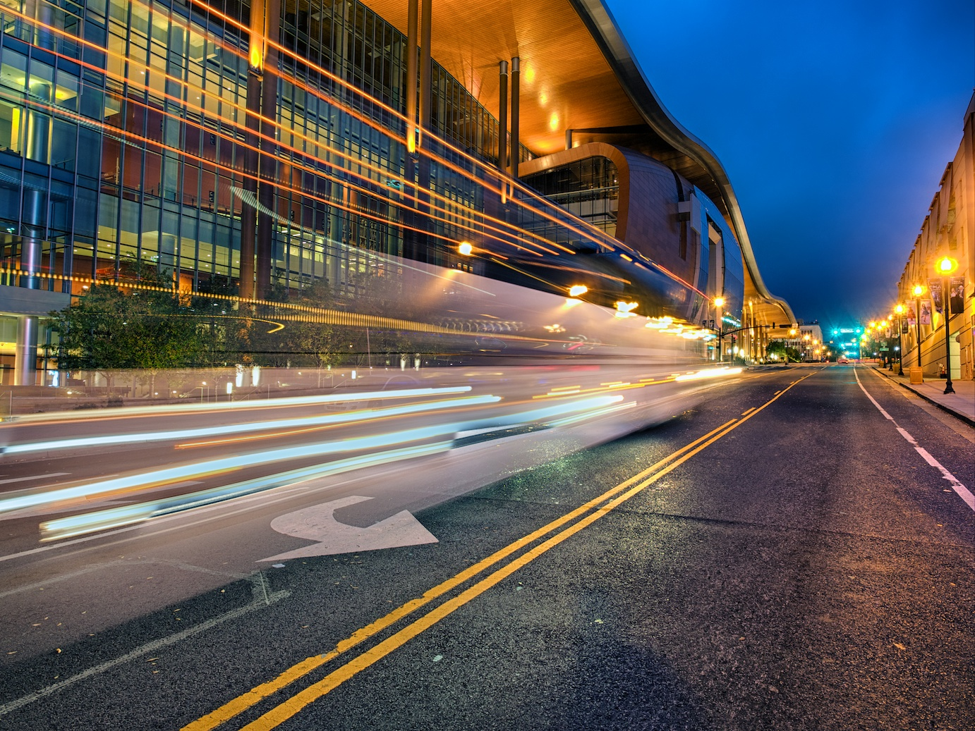 A bus passes in front of the Music City Center