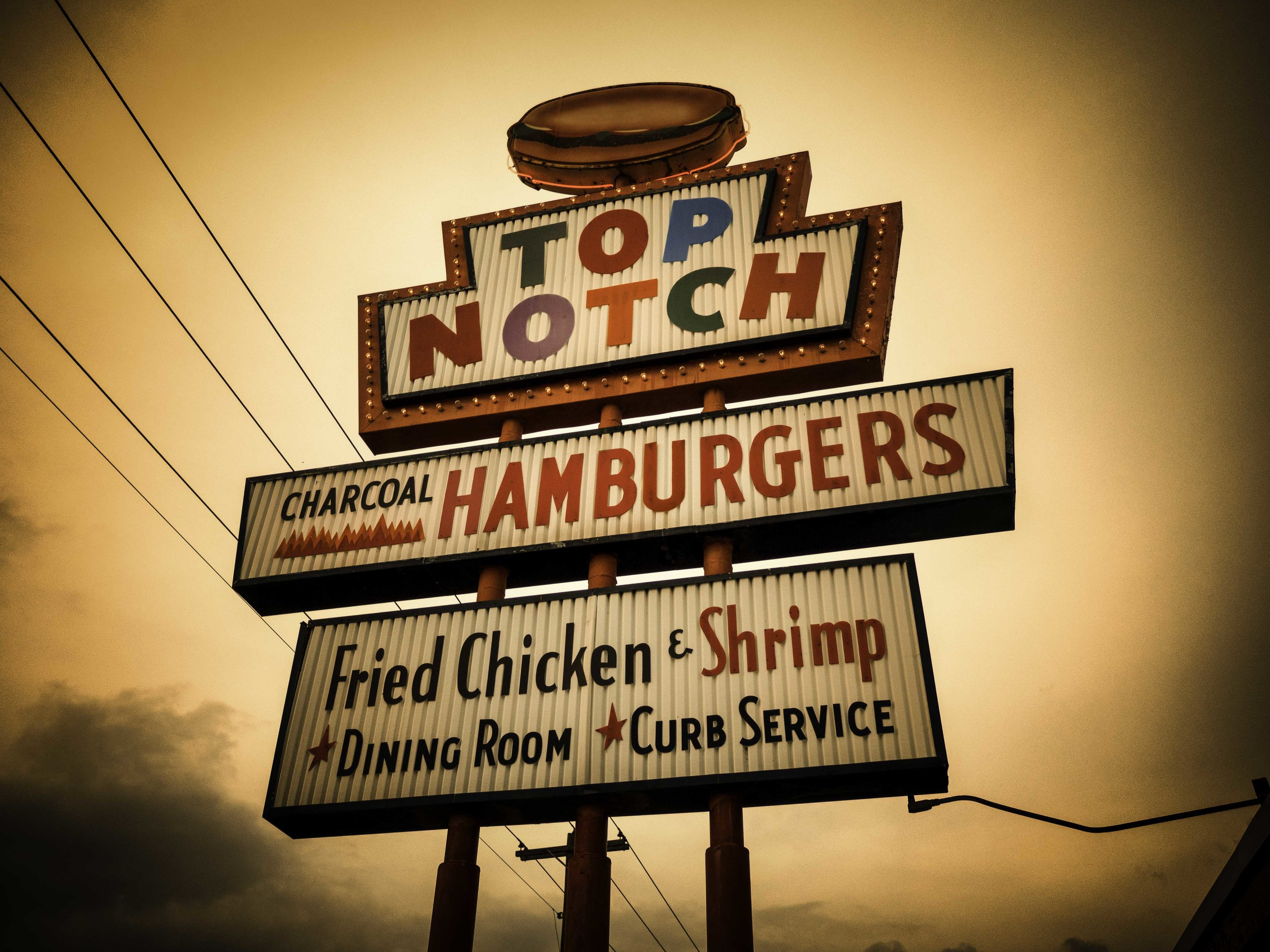 Top Notch Burgers is famous for being in the movie Dazed and Confused, which included local celebMatthew McConaughey. I have never seen him here.