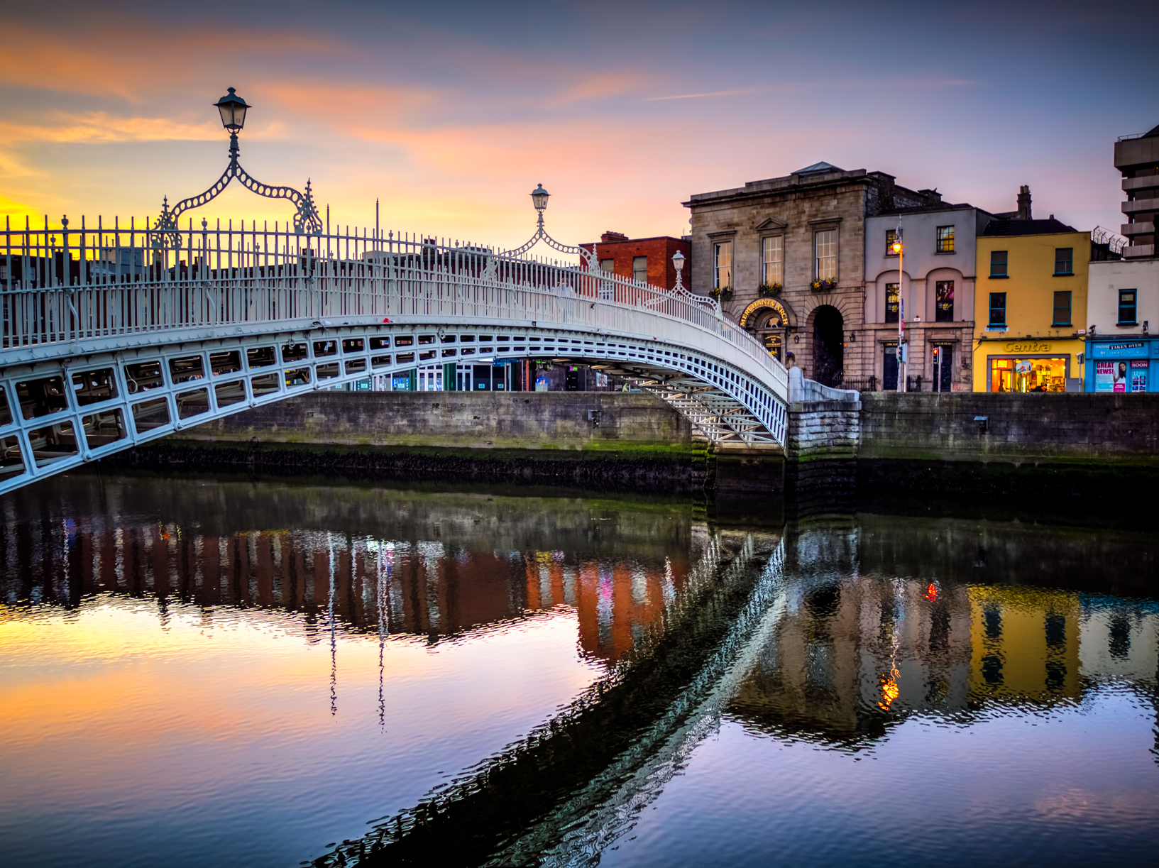 the ha'penny bridge looking all awesome at sunrise over the river liffey