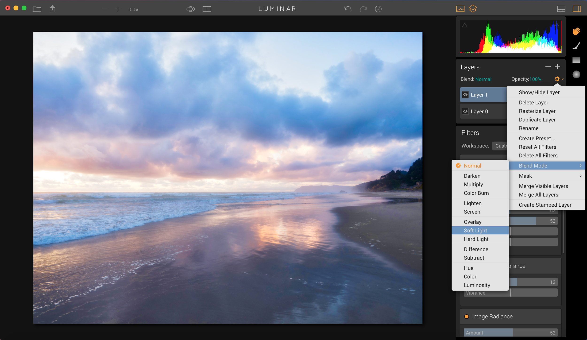 You can choose to blend the layers together in various ways using blend modes. They are accessible via the drop down menu that looks like a little gear icon.