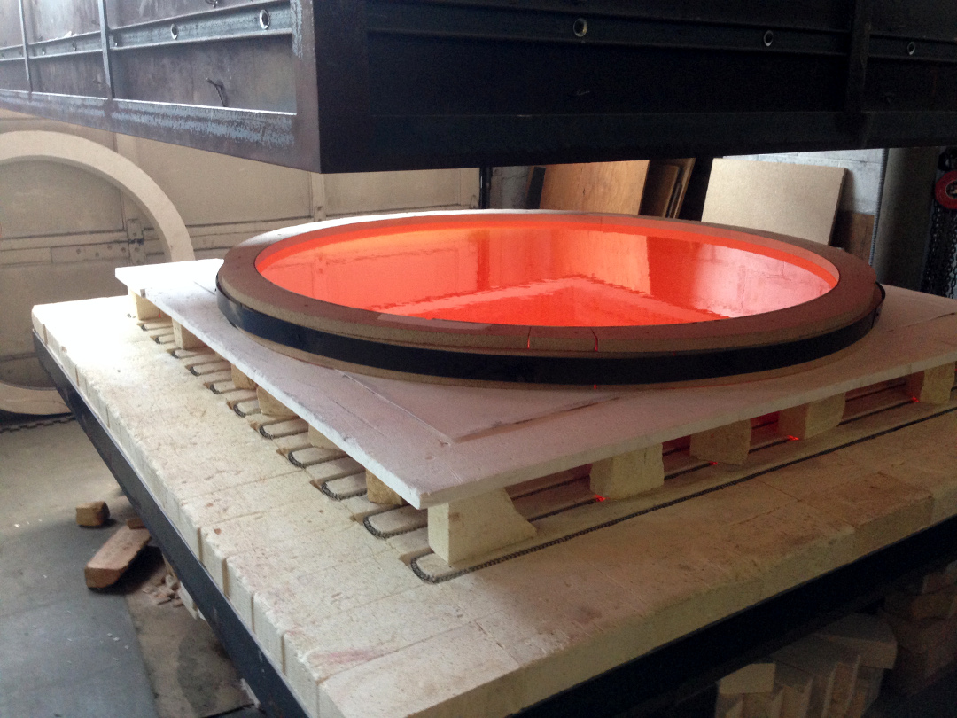 800 lbs of molten glass at 1500 degrees.