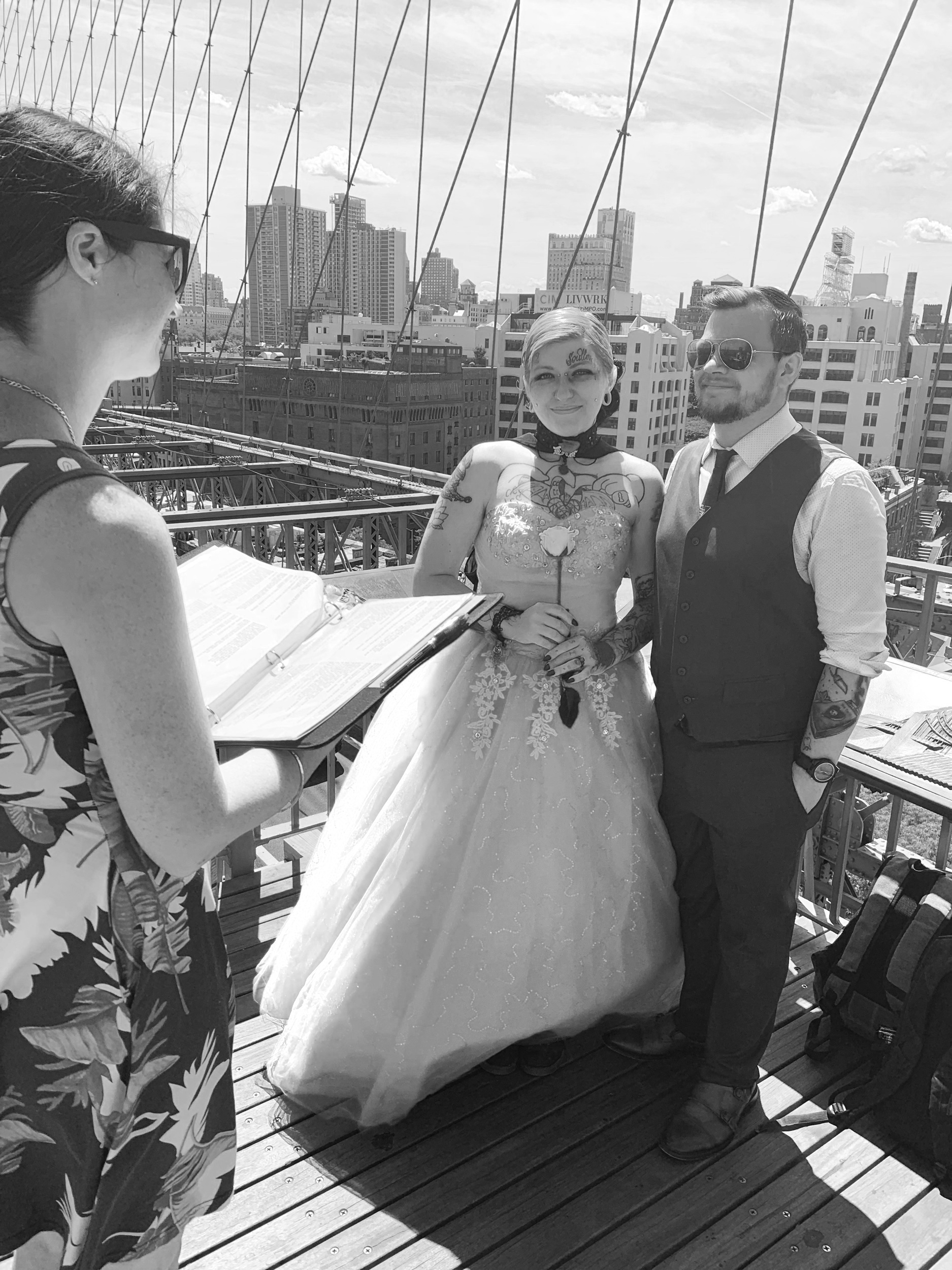 Uniting a couple in marriage on the Brooklyn Bridge.
