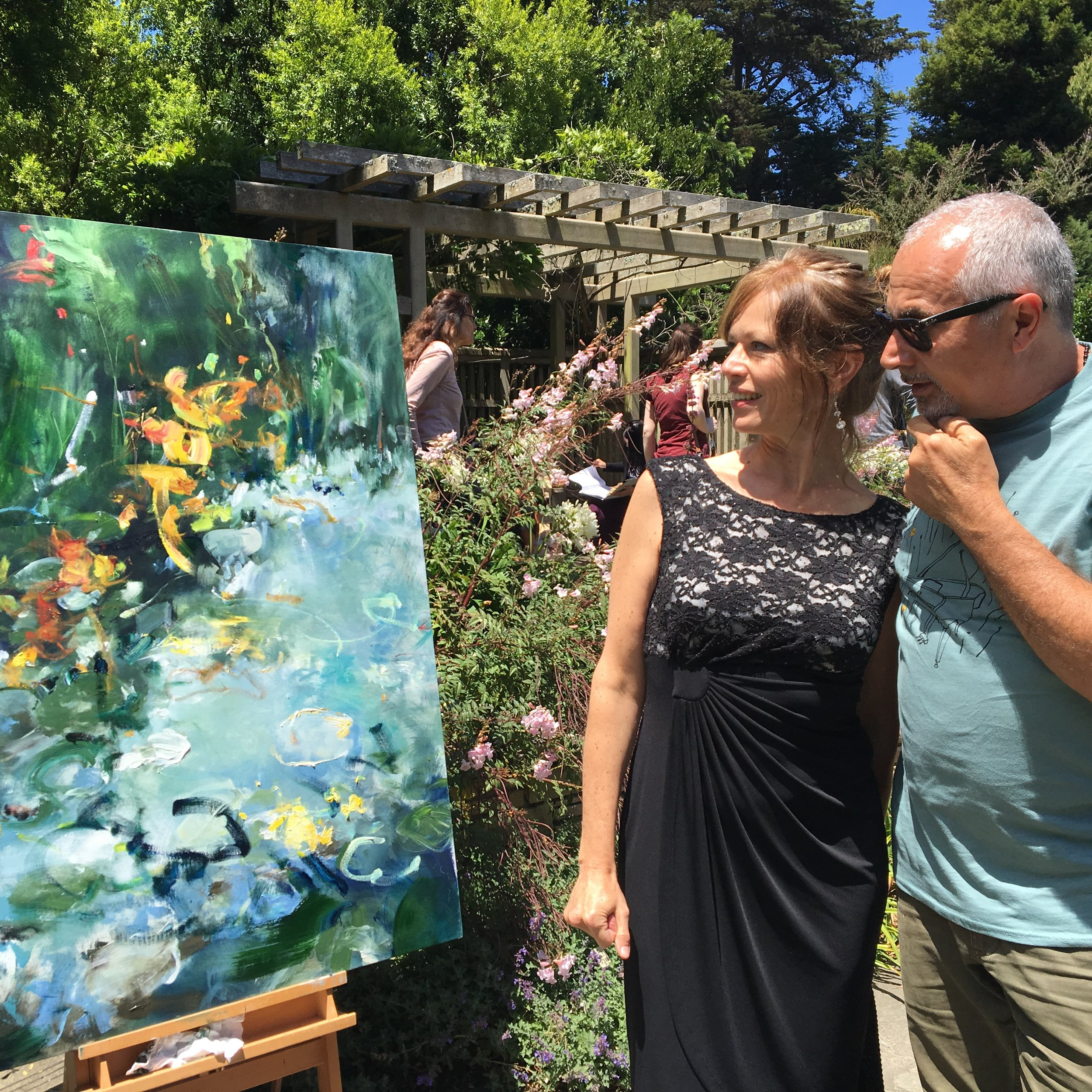 "Pianist Allison Lovejoy, and Flower Piano co-founder Mauro ffortissimo looking at my painting inspired by Allison's performance of Heitor Villa-Lobos ""Suite Florale"""
