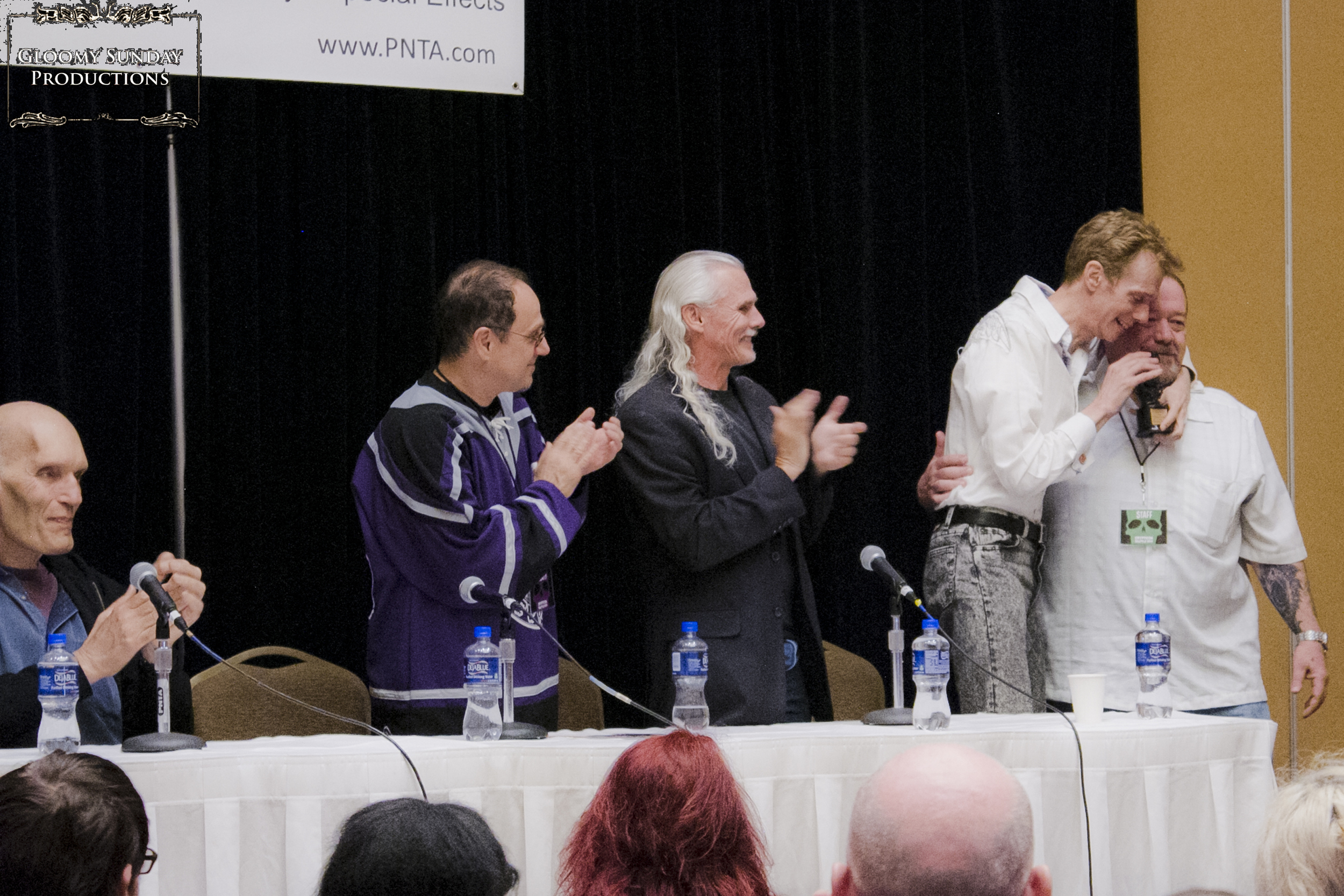 Doug Jones receiving the  Crypticon Icon Award  from resident sculptor William Bivens.
